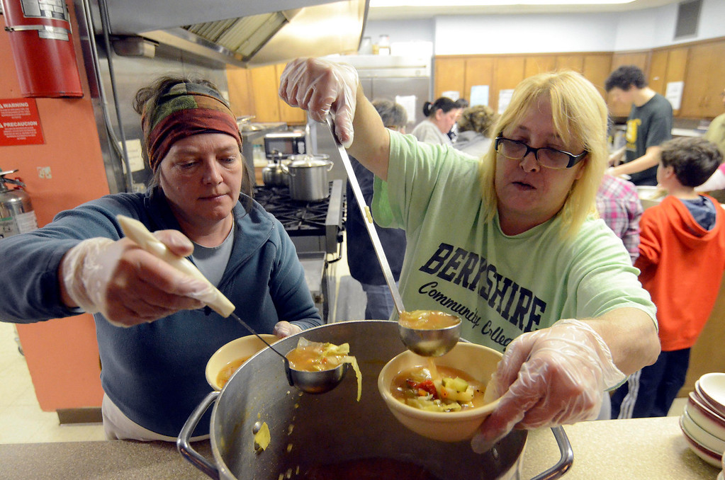 Description of . Kelly Austin-Rolo and Kathy Austin serve a harvest soup at the First United Methodist Church in Pittsfield in honor of Martin Luther King Jr. Day on Monday, Jan. 20, 2014.  (Ben Garver / Berkshire Eagle Staff)