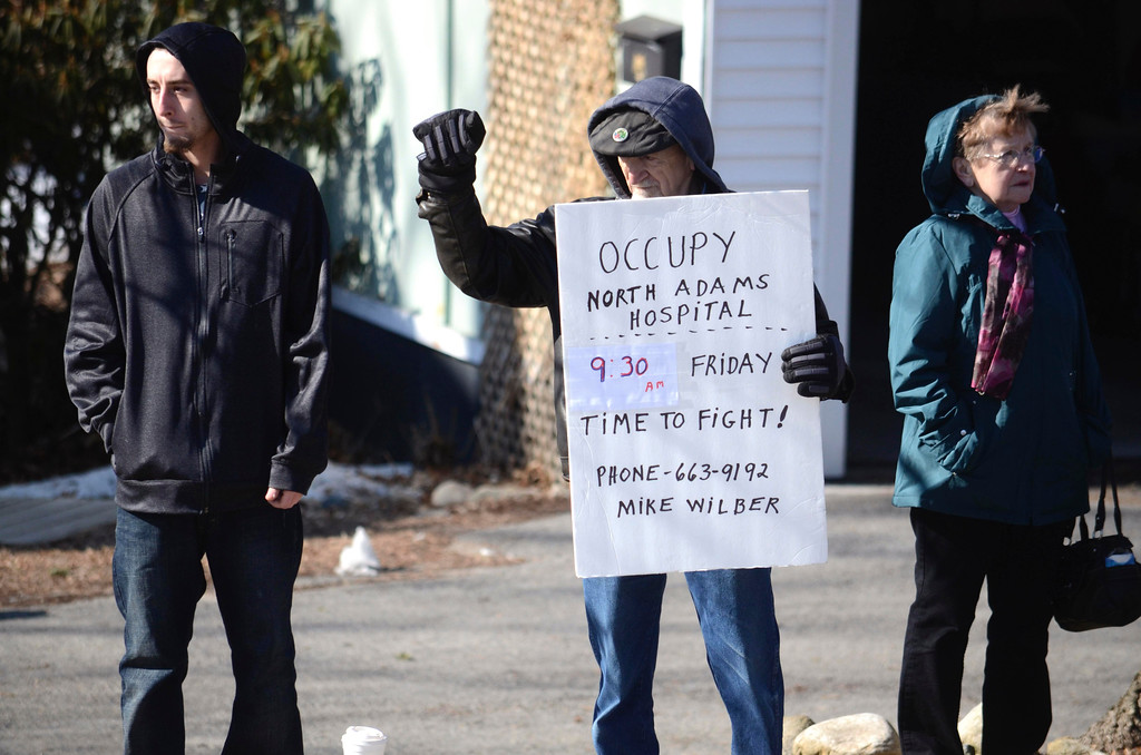 Description of . Mike Wilbur holds an sign outside of the Hospital organizing the protests. Thursday, March 27, 2014. Ben Garver / Berkshire Eagle Staff / photos.berkshireeagle.com