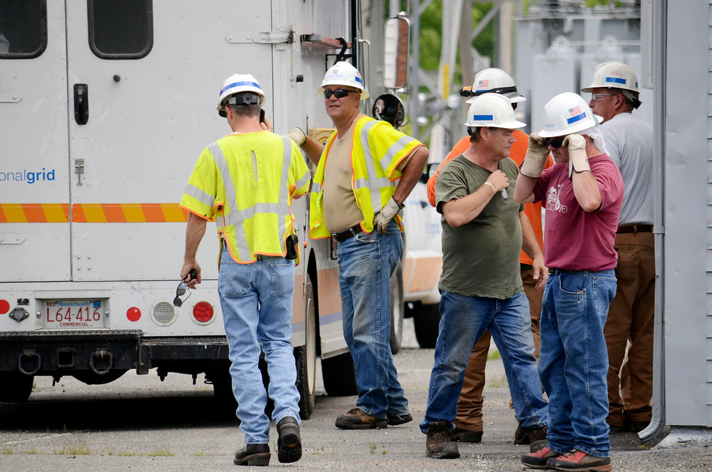 Description of . A crew from National Grid prepares to work at the Adams substation after a blackout hit North Berkshire County. Tuesday July 8, 2014.  Ben Garver / Berkshire Eagle Staff / photos.berkshireeagle.com