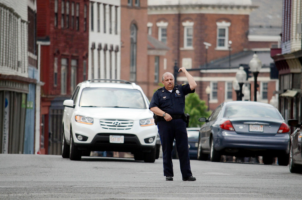 Description of . North Adams police officer Alan LaBonte directs traffinc at the Intersection of Route 2 and Eagle Street during a power outage, Tuesday July8, 2014.  Ben Garver / Berkshire Eagle Staff / photos.berkshireeagle.com