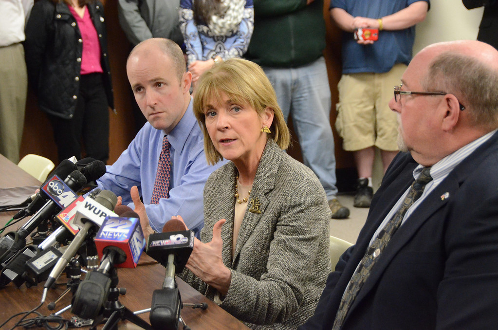Description of . Attorney General Martha Coakley speaks to the media in North Adams City Hall after meeting with State Senator Benjamin Downing, left, Mayor Richard Alcombright, right, and State Representative Gailanne Cariddi, not shown, on Tuesday, April, 1, 2014. Gillian Jones / Berkshire Eagle Staff / photos.berkshireeagle.com