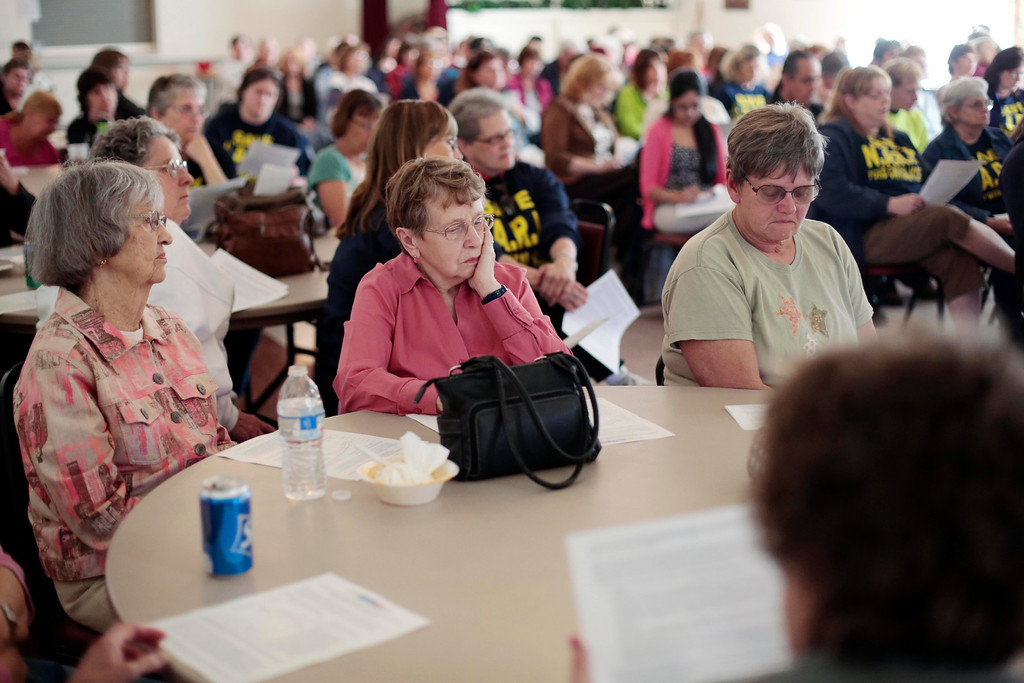 Description of . A financial analysis of the time leading up to the hospital's closure was passed out to former NARH employees and community members during a meeting at the American Legion in North Adams. Tuesday, May 6, 2014. Stephanie Zollshan / Berkshire Eagle Staff / photos.berkshireeagle.com