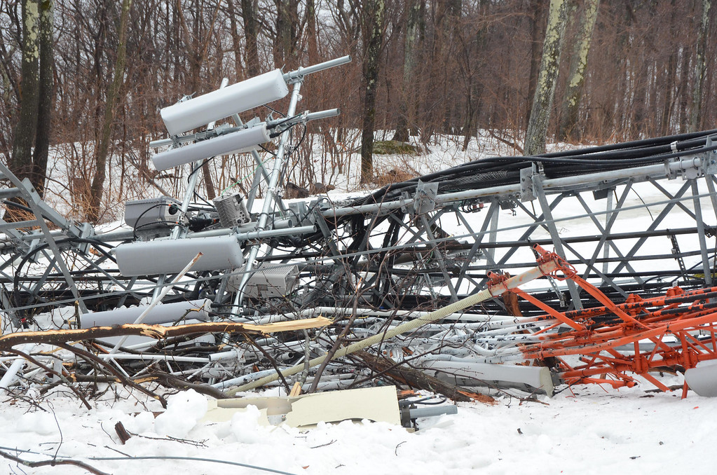 Description of . High winds overnight have toppled the communications tower on Florida Mountain at the Western Summit in North Adams impacting cell service to North Adams and some surrounding communities. Gillian Jones / Berkshire Eagle Staff / photos.berkshireeagle.com