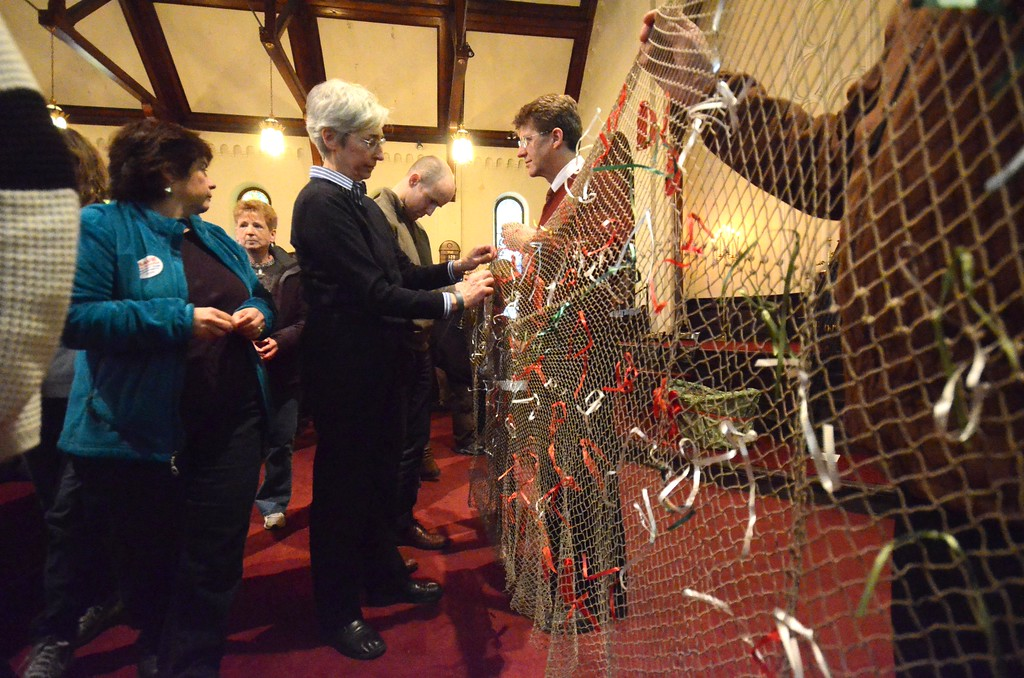 Description of . Rep. Gailanne Cariddi and State Senator Benjamin Downing join members of the community and NARH former employees as they gather at the First Congregational Church in North Adams on Sunday, March, 30, 2014 for a vigil. People were asked to tie a ribbon, representing their worries, on a net as a symbolic gesture of casting one's worries away. Gillian Jones / Berkshire Eagle Staff / photos.berkshireeagle.com