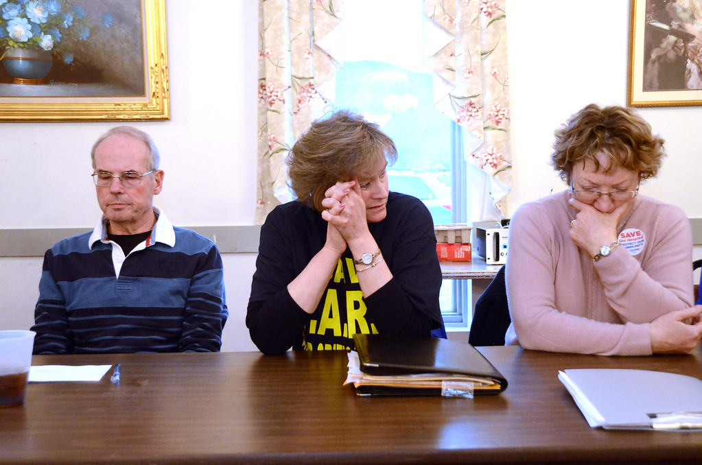 Description of . From left, Mike O'Brien, Robbin Simonetti and Diane George listen during a weekly meeting at the American Legion Post 125 in North Adams which provides the community with updates on the closing of NARH on Tuesday, April, 8, 2014. Gillian Jones / Berkshire Eagle Staff / photos.berkshireeagle.com