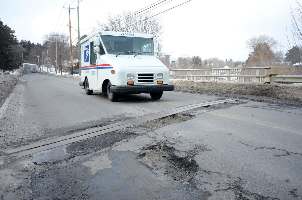 Description of . It is that time of year again for potholes. These are on Pomeroy Avenue in Pittsfield. Gillian Jones/Berkshire Eagle Staff