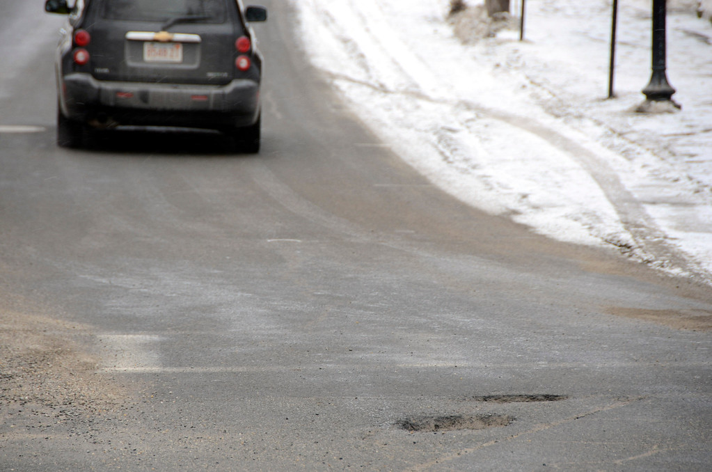 Description of . It is that time of year again for potholes. These are at Monument Square at the intersection of Church, East Main and Main Streets in North Adams. Gillian Jones/Berkshire Eagle Staff