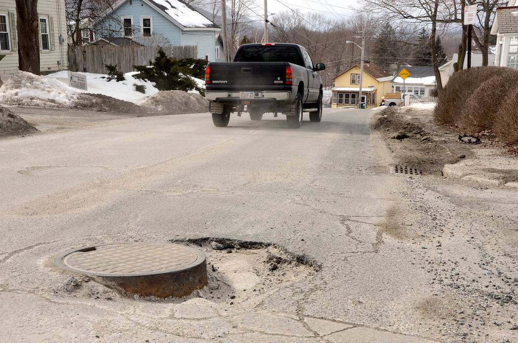 Description of . It is that time of year again for potholes. This one is on Franklin Street in North Adams. Gillian Jones/Berkshire Eagle Staff