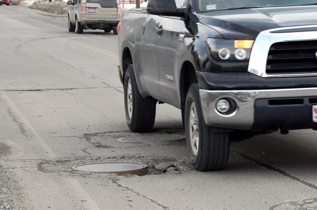 Description of . It is that time of year again for potholes. These are on Elm Street in Pittsfield. Gillian Jones/Berkshire Eagle Staff