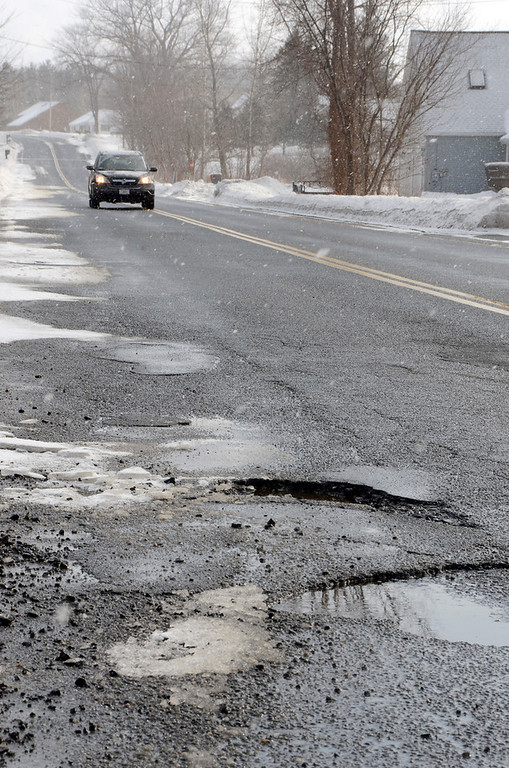 Description of . It is that time of year again for potholes. These are on East Road Adams. Gillian Jones/Berkshire Eagle Staff