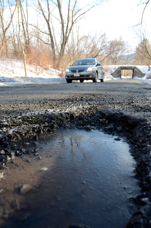 Description of . It is that time of year again for potholes. These are on Demond Avenue in North Adams. Gillian Jones/Berkshire Eagle Staff