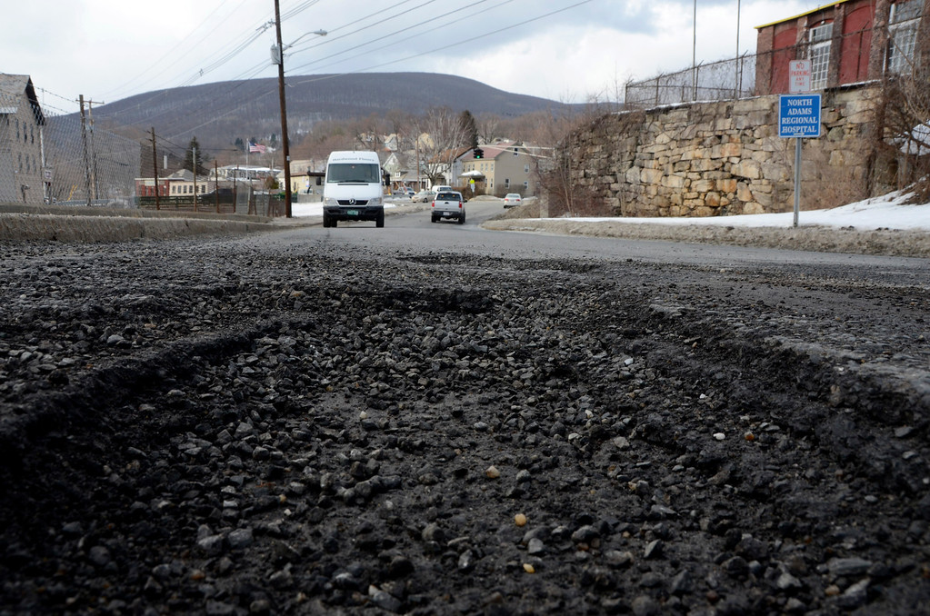 Description of . It is that time of year again for potholes. These are on Canal Street in North Adams. Gillian Jones/Berkshire Eagle Staff