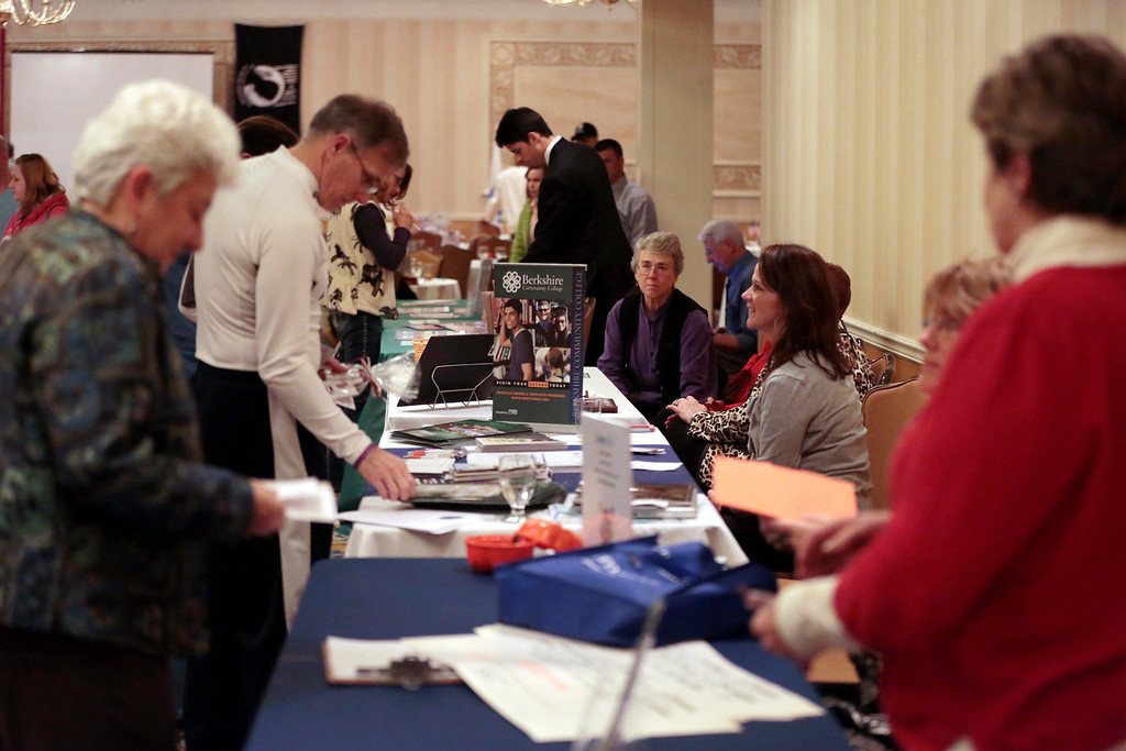 Description of . Veterans, exhibitors and community members attend a Veteran's Expo at the Crowne Plaza hotel in Pittsfield. Friday, November 15, 2013. (Stephanie Zollshan | Berkshire Eagle Staff)