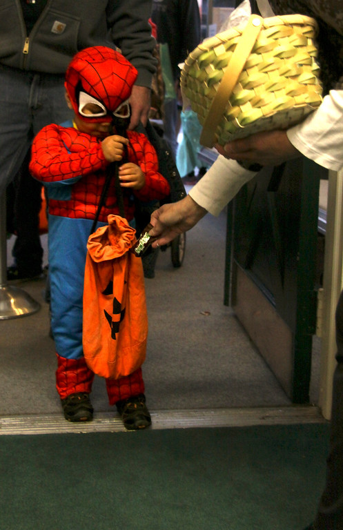 Description of . Spencer Doyle 3 years old of Pittsfield collects candy during the 3rd Thursday event where the theme was monster mash. Children were invited to trick or treat and wear their costumes. 10/17/13 Holly Pelczynski/Berkshire Eagle Staff