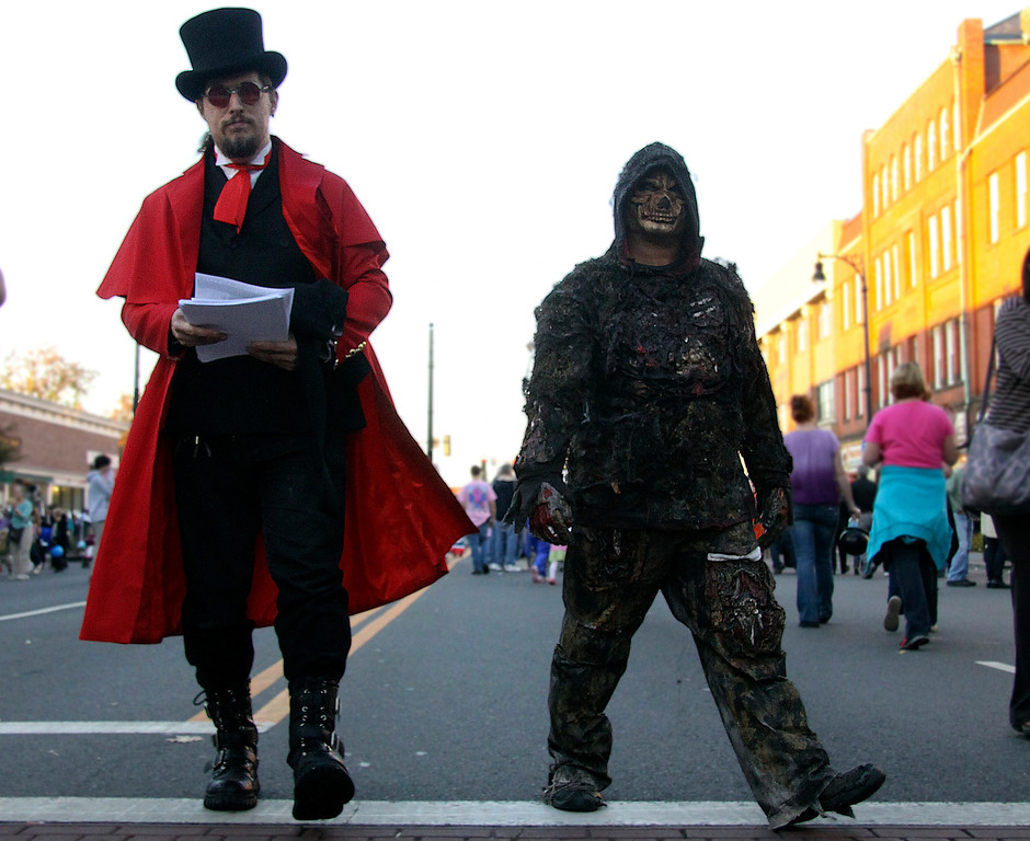Description of . James Eubanks and Joe Sumy of Pittsfield walk on North St. during the 3rd Thursday evernt held in Pittsfield. The Theme was Monster Mash, guest were invited to come to the block party and wear their scariest costumes. 10/17/13 Holly Pelczynski/Berkshire Eagle Staff