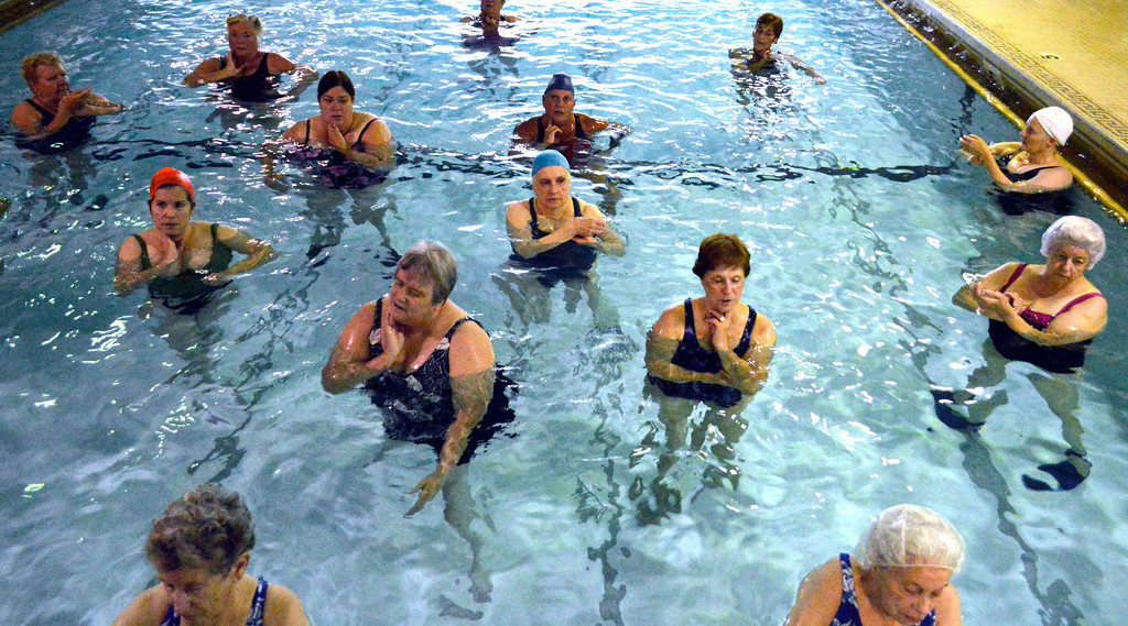 Description of . One of the more popular classes at the Dalton CRA for staying acice Spash-er-cise. Here the swimmers pause to monitor their pulse.  Wed Aug 15, 2012 (GARVER)