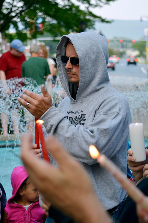 Description of . Toby Clayton holds a candle to honoto Trayvon Martin. At 7:17pm protesters lit candles in a vigil for Trayvon Martin in Park Square in Pittsfield, Wednesday July 17, 2013. Ben Garver / Berkshire Eagle Staff