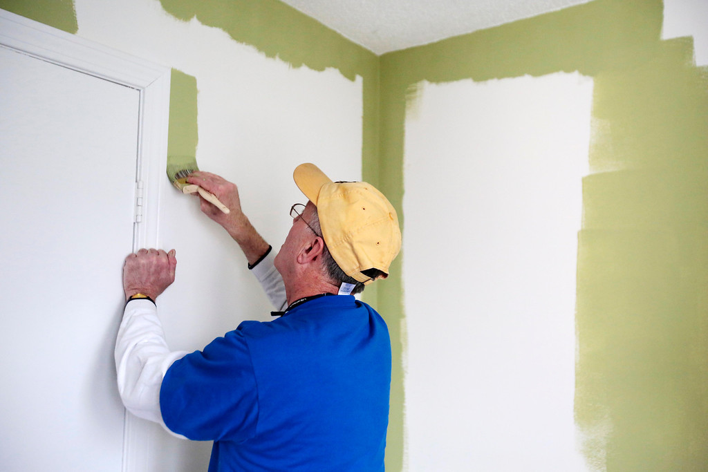 Description of . Mayor Daniel Bianchi joins AmeriCorps VISTA and the Retired Senior Volunteer Program (RSVP) in painting a room at the Central Berkshire Habitat for Humanity office in Pittsfield as he participates in the Mayors Day of Recognition for National Service. Tuesday, April 1, 2014. Stephanie Zollshan / Berkshire Eagle Staff / photos.berkshireeagle.com