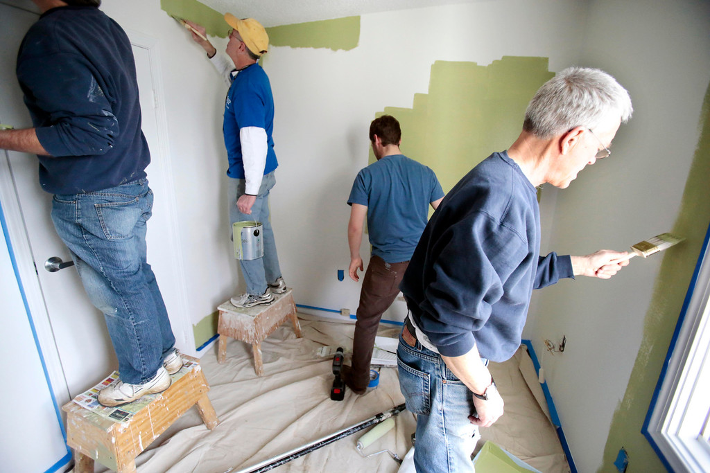 Description of . Mayor Daniel Bianchi, center left, joins AmeriCorps VISTA and the Retired Senior Volunteer Program (RSVP) in painting a room at the Central Berkshire Habitat for Humanity office in Pittsfield as he participates in the Mayors Day of Recognition for National Service. Tuesday, April 1, 2014. Stephanie Zollshan / Berkshire Eagle Staff / photos.berkshireeagle.com