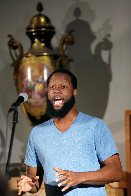 Description of . Guest poet Jive Poetic performs his poems as the results are being tallied after the WordXWord storytelling finals at the Berkshire Museum in Pittsfield at the end of the week of WordXWord performances and workshops. Friday, August 22, 2014. Stephanie Zollshan / Berkshire Eagle Staff / photos.berkshireeagle.com