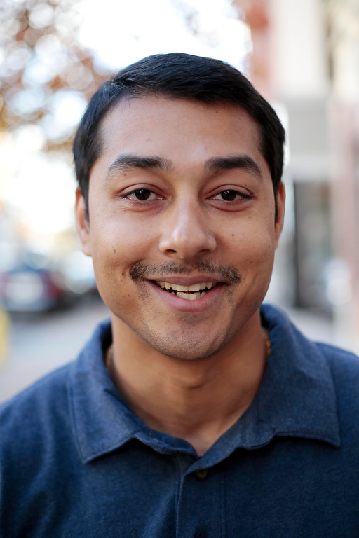 Description of . Sumi Basnet sports his 'Movember' moustache in Pittsfield. Friday, November 8, 2013. (Stephanie Zollshan | Berkshire Eagle Staff)