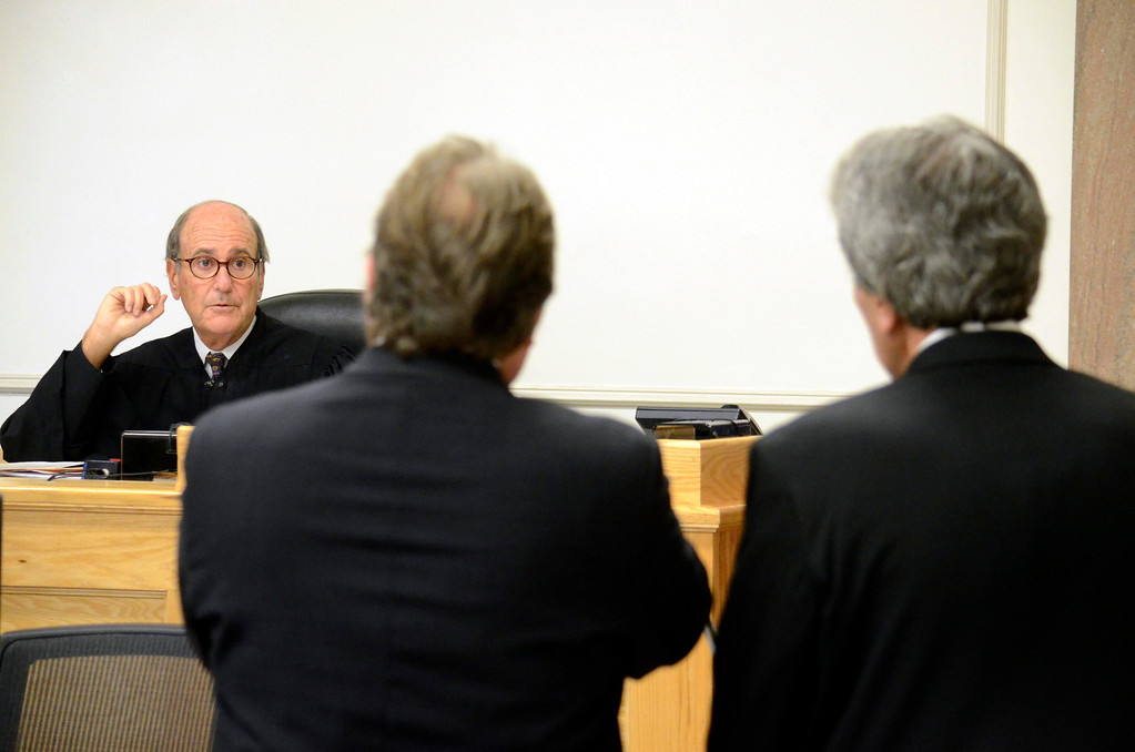 Description of . District Judge Fredric Rutberg speaks to attorney Timothy Shugrue and Paul Capitanio (right) during Capitanio's arraignment on drug related charges.  Tuesdau August 20, 2013. Ben Garver / Berkshire Eagle Staff