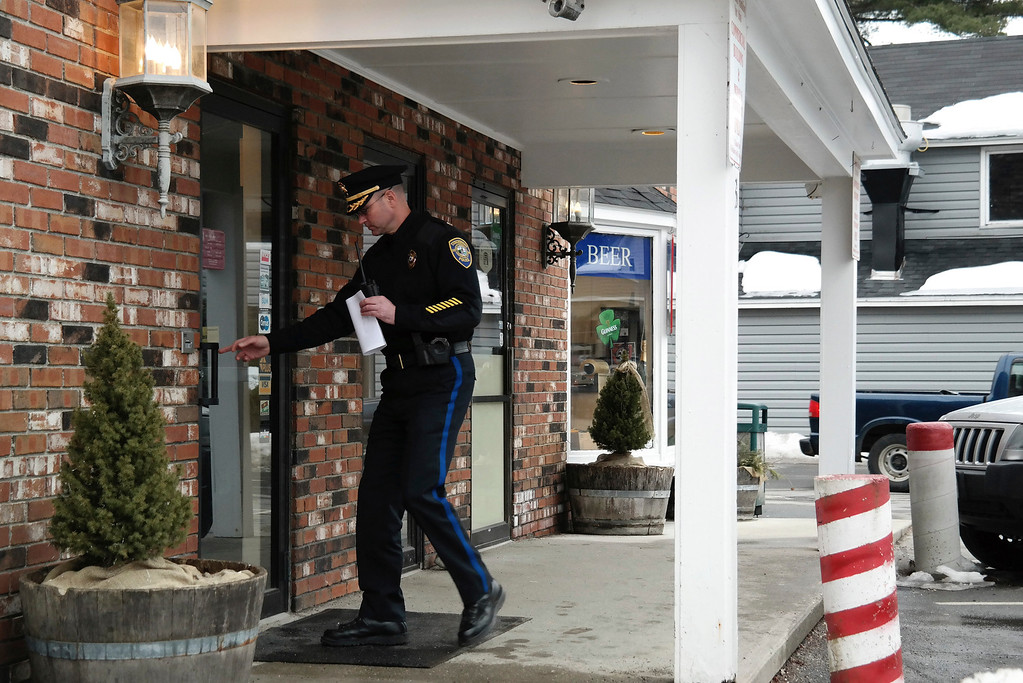 Description of . Stockbridge Police Chief Robert Eaton enters the Lee Bank branch located on Elm Street in Stockbridge to investigate an alleged robbery that took place there Monday afternoon. Ben Garver/Berkshire Eagle Staff Monday, March 10, 2014