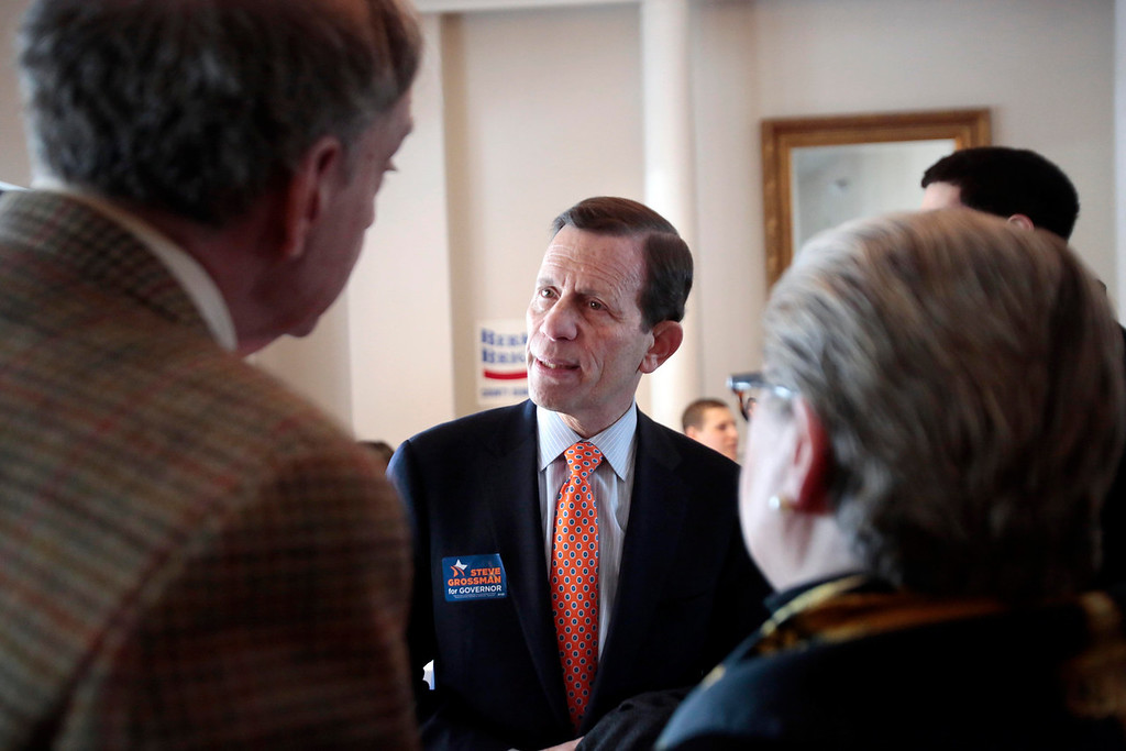 Description of . Candidate Steve Grossman talks with supporters at a Democratic party gubernatorial candidate meet-and-greet held by the Berkshire Brigades at the ITAM lodge in Pittsfield. Sunday, January 26, 2014. (Stephanie Zollshan   Berkshire Eagle Staff)
