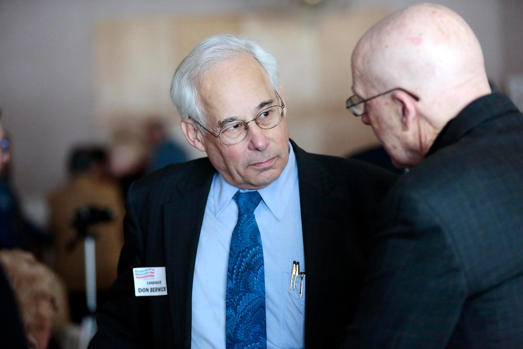 Description of . Candidate Don Berwick talks with supporters at a Democratic party gubernatorial candidate meet-and-greet held by the Berkshire Brigades at the ITAM lodge in Pittsfield. Sunday, January 26, 2014. (Stephanie Zollshan   Berkshire Eagle Staff)