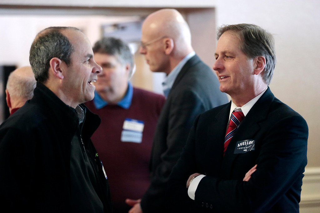 Description of . Candidate Joe Avellone, right, talks with supporters at a Democratic party gubernatorial candidate meet-and-greet held by the Berkshire Brigades at the ITAM lodge in Pittsfield. Sunday, January 26, 2014. (Stephanie Zollshan   Berkshire Eagle Staff)