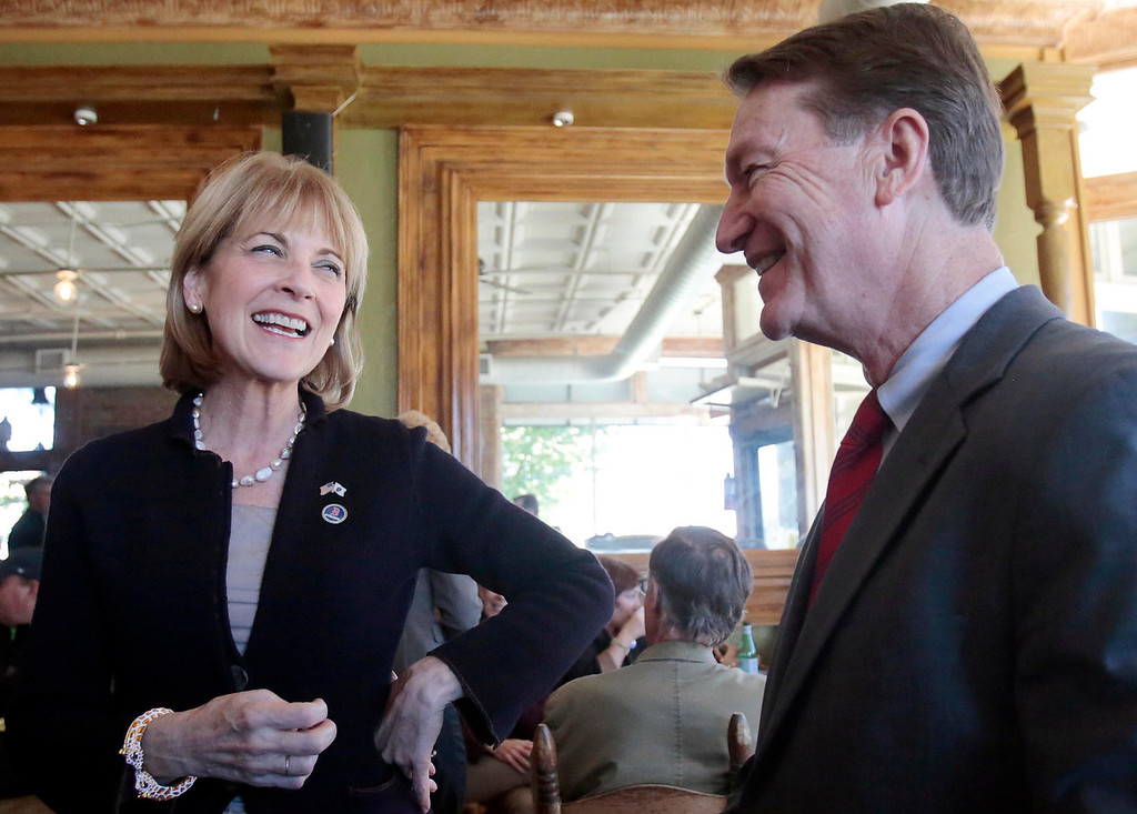 Description of . Martha Coakley chats with District Attorney David Capeless at Dottie's Coffee Lounge in Pittsfield during a tour of Massachusetts cities to announce her candidacy for governor. Tuesday, September 17, 2013. Stephanie Zollshan/Berkshire Eagle Staff.