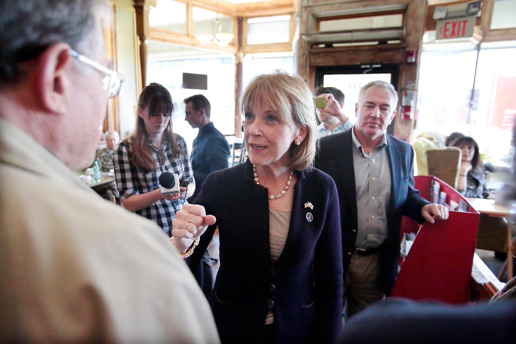 Description of . Martha Coakley visits with supporters at Dottie's Coffee Lounge in Pittsfield during a tour of Massachusetts cities to announce her candidacy for governor. Tuesday, September 17, 2013. Stephanie Zollshan/Berkshire Eagle Staff.
