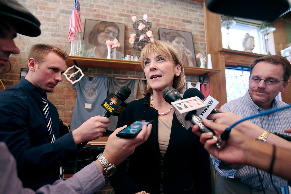 Description of . Martha Coakley answers questions from reporters at Dottie's Coffee Lounge in Pittsfield during a tour of Massachusetts cities to announce her candidacy for governor. Tuesday, September 17, 2013. Stephanie Zollshan/Berkshire Eagle Staff.
