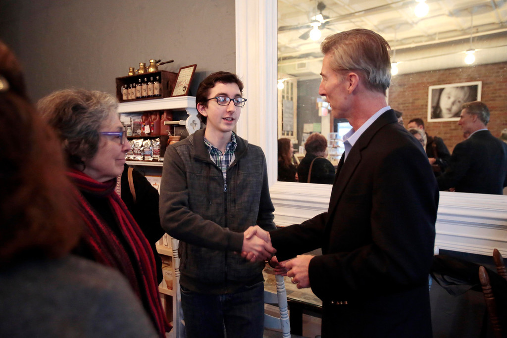Description of . Tom Conroy meets Jacob Edelman and other supporters at Dottie's Cafe in Pittsfield during a stop on his campaign trail for state treasurer. Sunday, January 12, 2014. (Stephanie Zollshan | Berkshire Eagle Staff)