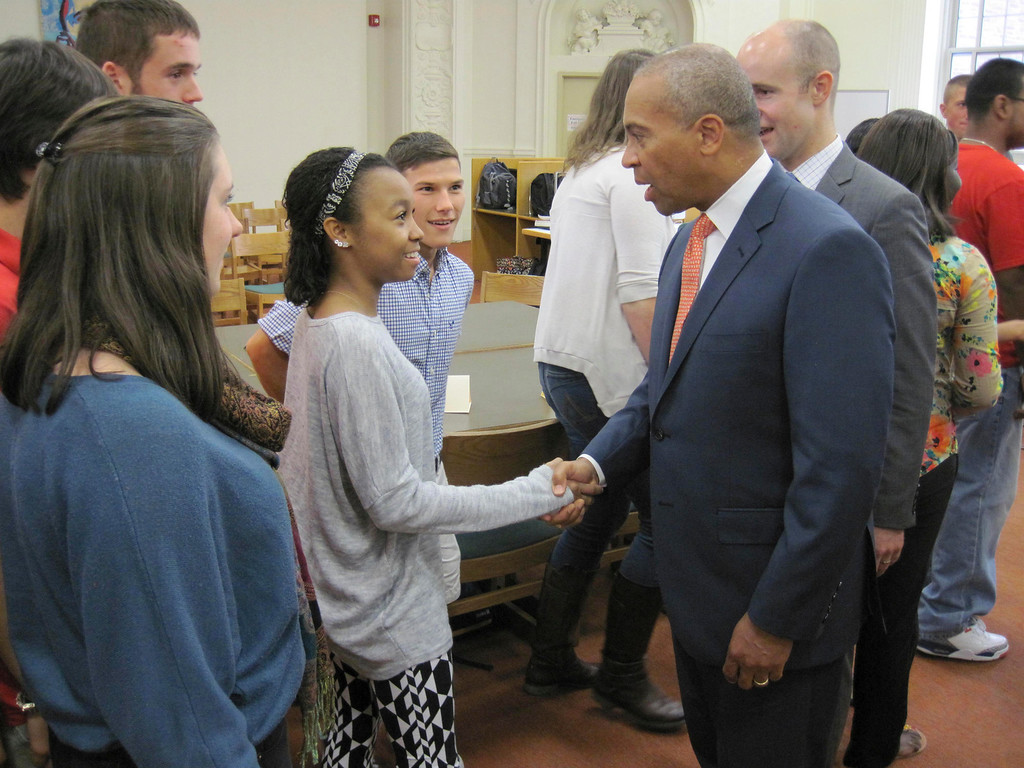 Description of . Pittsfield High School senior Aja Jackson shakes hands with Gov. Deval Patrick, as senior Dimitri Pixley looks on. PHS students met with the governor and other state and local officials during a special roundtable forum held Monday in the school library. Jenn Smith/Berkshire Eagle Staff
