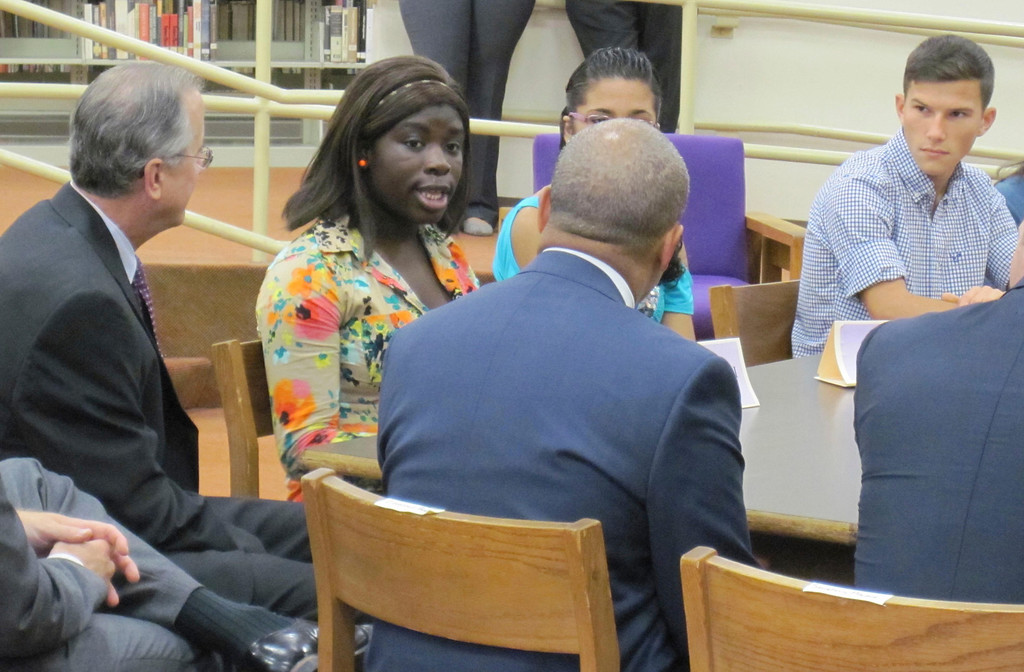 Description of . Pittsfield High School senior Christine Ahoussi speaks with Gov. Deval Patrick during a student forum held Monday at the school with state and local officials. Jenn Smith/Berkshire Eagle Staff Monday, Oct. 7, 2013