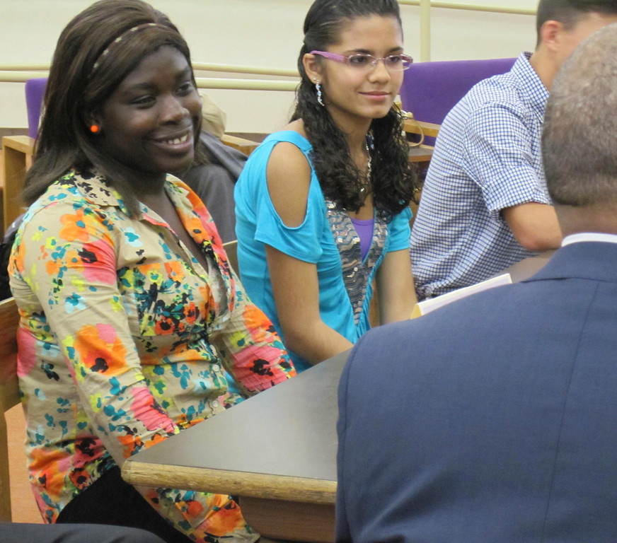 Description of . Pittsfield High School seniors Christine Ahoussi (left) and Gladys Garcia (right) smile while chatting with Gov. Deval Patrick during a student forum held Monday at the school with state and local officials. Jenn Smith/Berkshire Eagle Staff Monday, Oct. 7, 2013