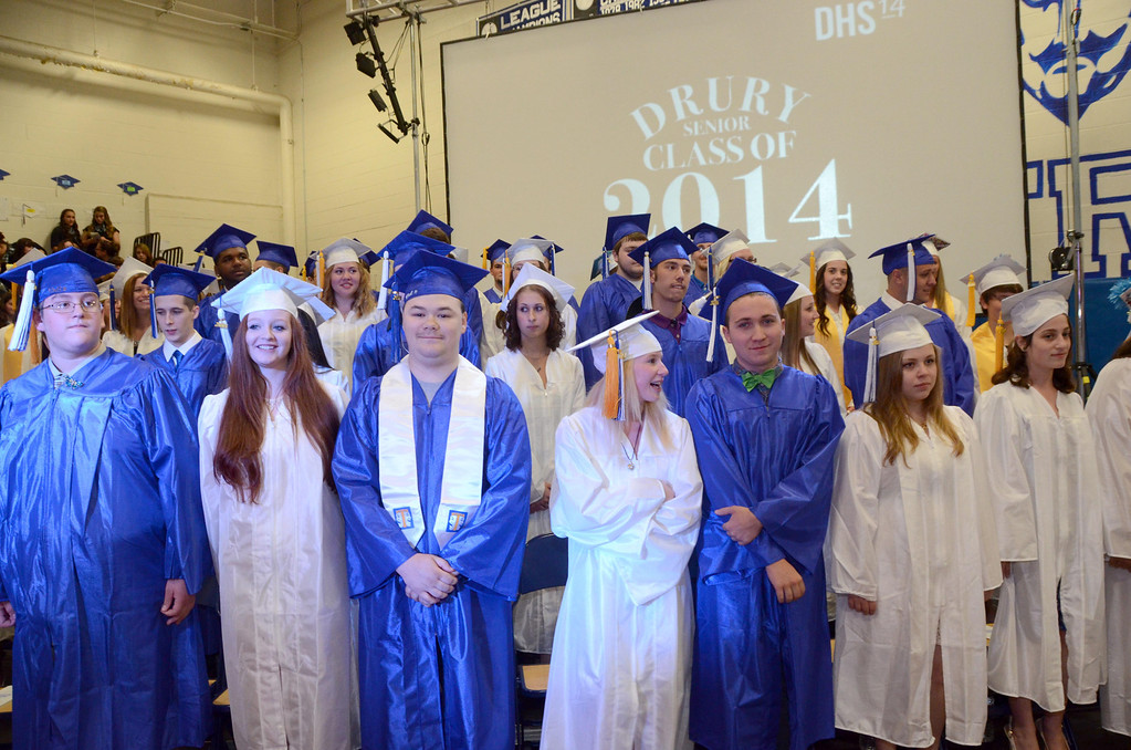 Description of . Seniors stand after processing into Drury High School graduation exercises in the school gymnasium on Thursday, June, 12, 2014. Gillian Jones / Berkshire Eagle Staff / photos.berkshireeagle.com
