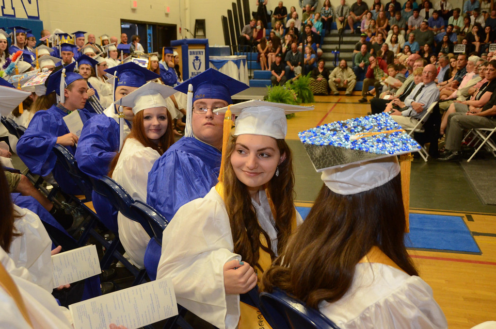 Description of . Graduates listen to their classmates perform in the chorus during Drury High School graduation exercises in the school gymnasium on Thursday, June, 12, 2014. Gillian Jones / Berkshire Eagle Staff / photos.berkshireeagle.com