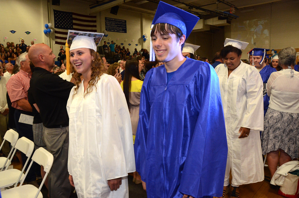 Description of . Seniors process into Drury High School graduation exercises in the school gymnasium on Thursday, June, 12, 2014. Gillian Jones / Berkshire Eagle Staff / photos.berkshireeagle.com