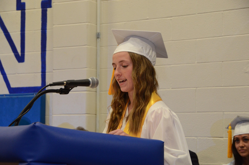 Description of . Alison Tassone gives the salutatory address during Drury High School graduation exercises in the school gymnasium on Thursday, June, 12, 2014. Gillian Jones / Berkshire Eagle Staff / photos.berkshireeagle.com