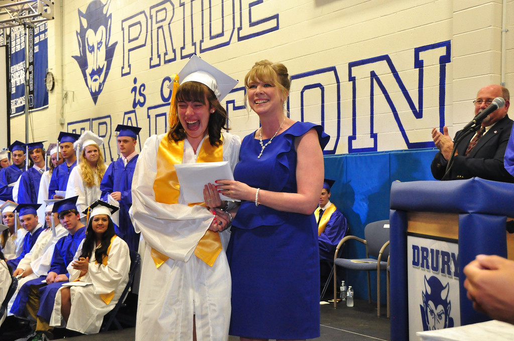 Description of . Allison Meehan reacts to getting her high school diploma from her mother, and Principal Amy Meehan during Drury High School graduation exercises in the school gymnasium on Thursday, June, 12, 2014. Gillian Jones / Berkshire Eagle Staff / photos.berkshireeagle.com