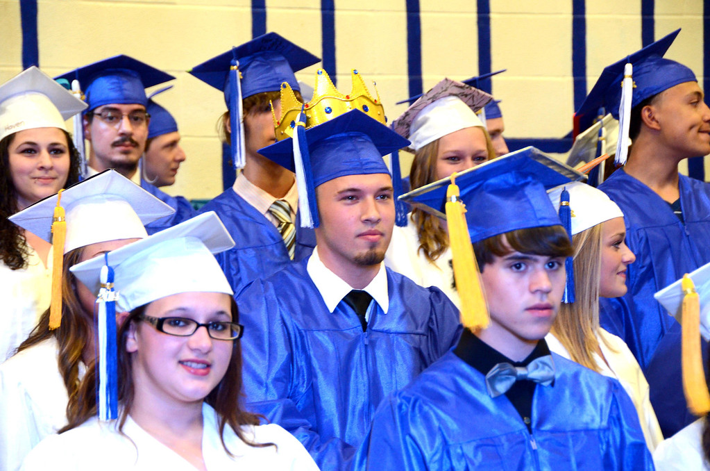 Description of . Most students decorated their mortar board and Brandon Koprowski put a crown on top of his during Drury High School graduation exercises in the school gymnasium on Thursday, June, 12, 2014. Gillian Jones / Berkshire Eagle Staff / photos.berkshireeagle.com