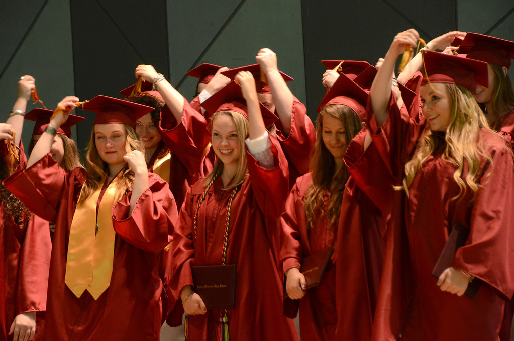 Description of . Students move their tassels to the other side following receiving their diplomas at Lenox Memorial High School graduation at Tanglewood on Sunday, June, 8, 2014. Gillian Jones / Berkshire Eagle Staff / photos.berkshireeagle.com