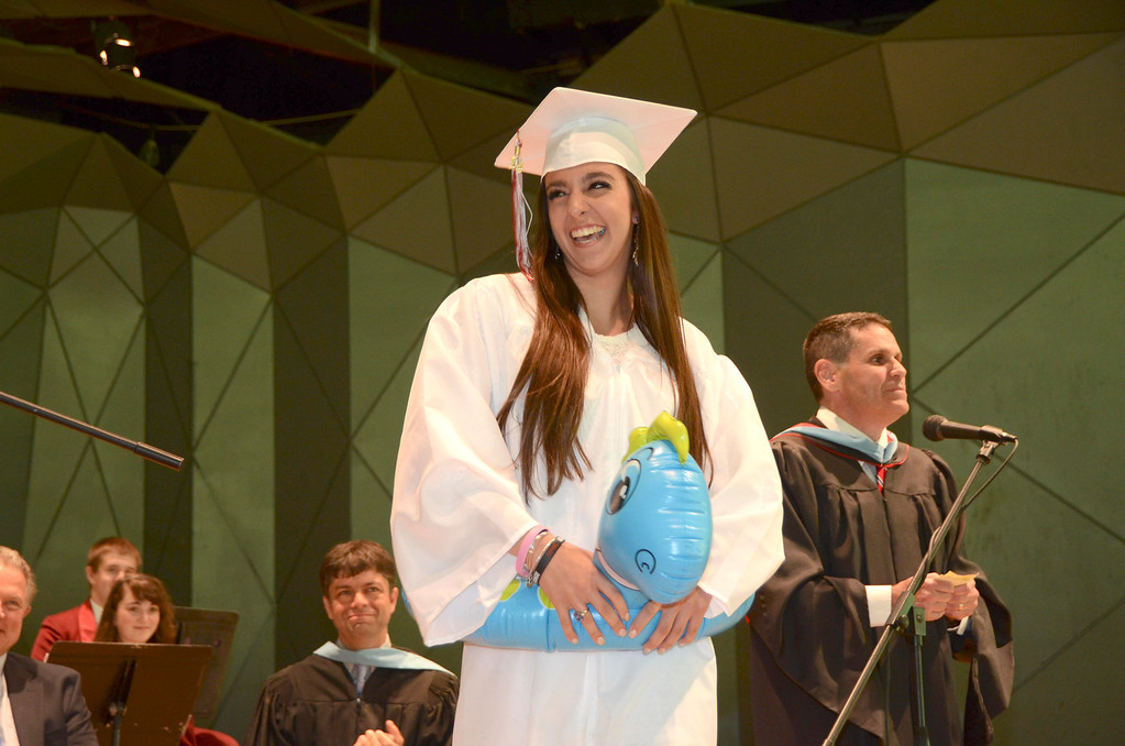 Description of . Alexa Nejaime wears an inflatable floatation device as she walks up to receive her diploma during Monument Mountain Regional High School exercises at Tanglewood in Lenox on Sunday, June, 1, 2014. Gillian Jones / Berkshire Eagle Staff / photos.berkshireeagle.com
