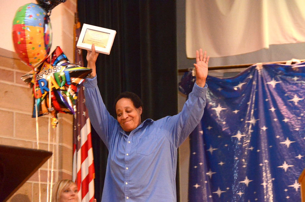 Description of . Carolyn Y. Brown reacts after receiving the Linda Hermanski Positive Mindset Award during a PALC graduation and awards ceremony at Crosby Elementary School on Tuesday, June, 10, 2014. Gillian Jones / Berkshire Eagle Staff / photos.berkshireeagle.com