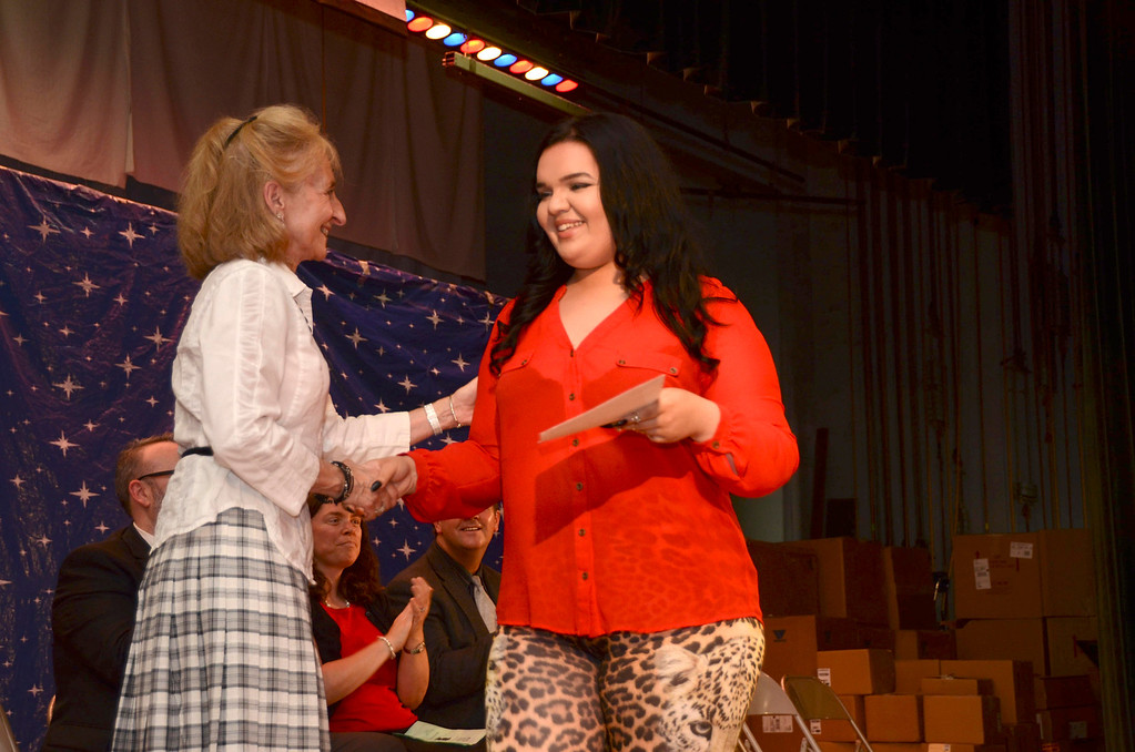 Description of . Gabriella M. Lombardi, who received the William Stickney Scholarship, receives her certificate from Katherine Yon, chairperson of the school committee, during a graduation and awards ceremony at Crosby Elementary School on Tuesday, June, 10, 2014. Gillian Jones / Berkshire Eagle Staff / photos.berkshireeagle.com