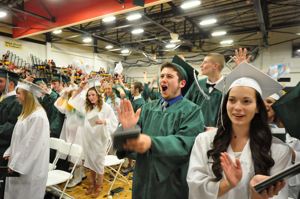 Description of . Center from left, Mitchell Malloy and Madilyn Luczynski celebrate during graduation exercises of McCann Technical School in the Amsler Campus Center at MCLA on Wednesday, June 4, 2014. Gillian Jones / Berkshire Eagle Staff / photos.berkshireeagle.com