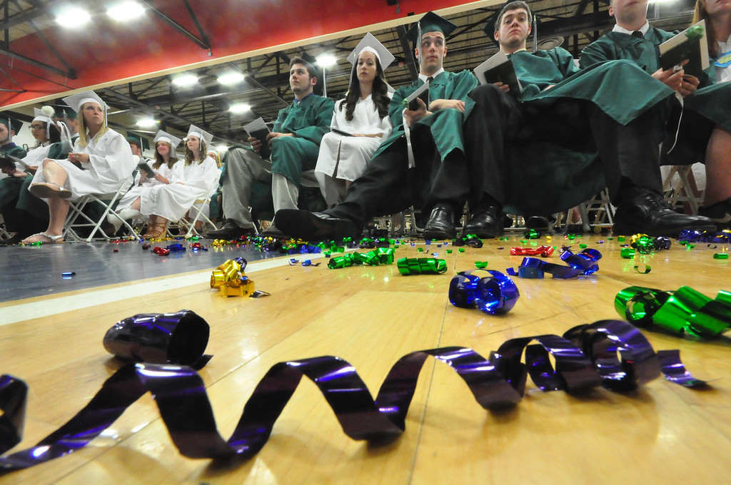 Description of . Streams of ribbon confetti sit on the floor after a celebration by students during graduation exercises of McCann Technical School in the Amsler Campus Center at MCLA on Wednesday, June 4, 2014. Gillian Jones / Berkshire Eagle Staff / photos.berkshireeagle.com