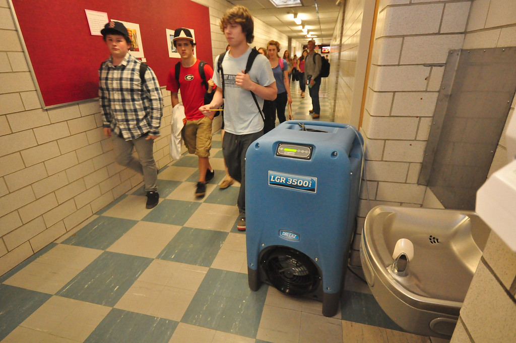 Description of . The humidity and other climate control issues at Mount Greylock Regional High School, are alleviated by humidifiers and fans throughout the building . Gillian Jones / Berkshire Eagle Staff / photos.berkshireeagle.com